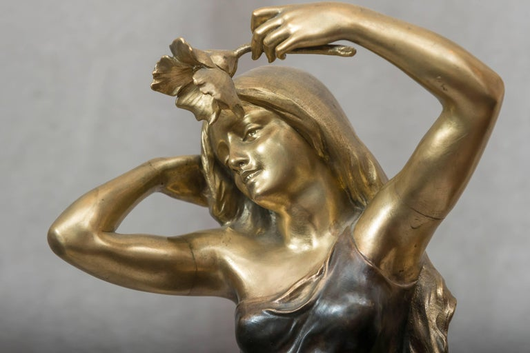 For the art nouveau lover, this is certainly worth one to ponder, for all others, here is fine example art nouveau. The two color patina makes this very desirable. Her beautiful gold hair and face make this bronze a real winner. Artist signed