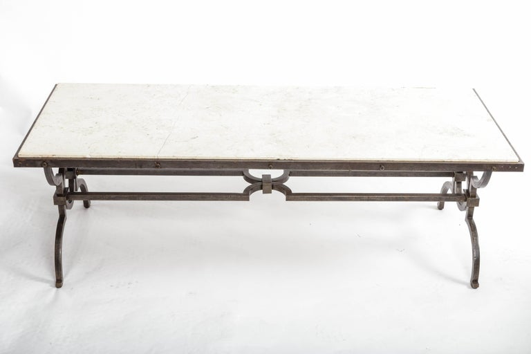 Black patinated and gilded wrought iron coffee table with a stone top by Gilbert Poillerat, France, 1940s.
