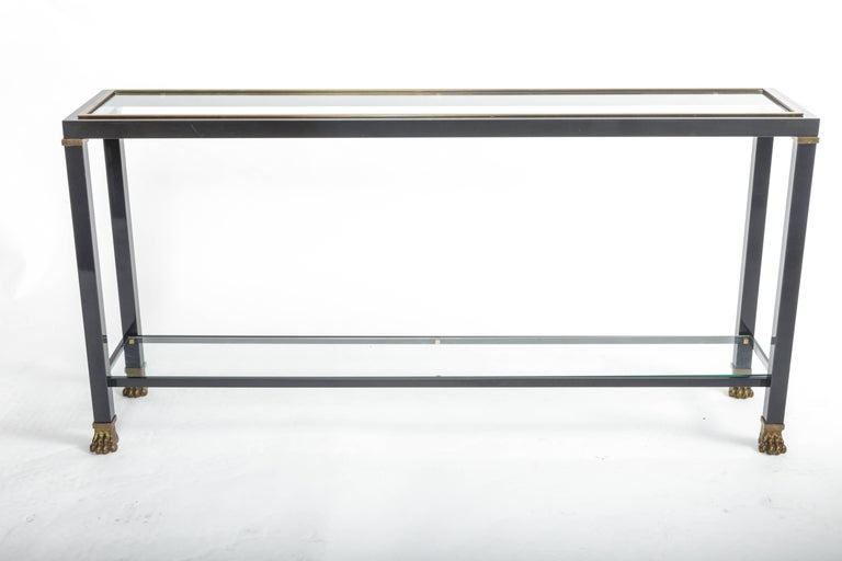 Two-tiered console with patinated metal and glass tops