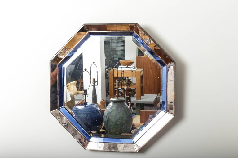 Octagonal mirror with blue and antiqued silver frame France, 20th century.