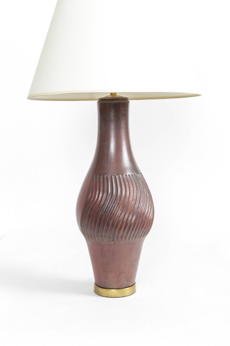 Large deep red ceramic and brass table lamp