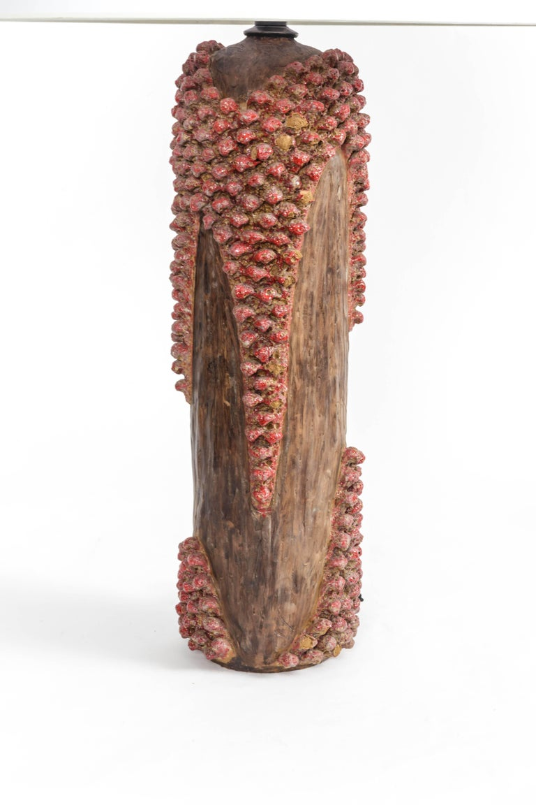 Textured red and brown ceramic lamp, France, 20th century.   Shade not included Newly rewired with black twisted silk cord and bronze finish on fittings.