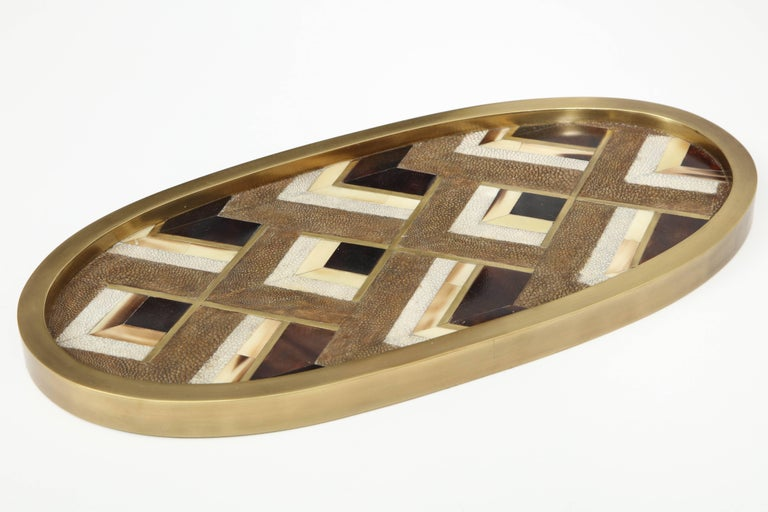 Decorative tray made of two color shagreen, palm wood and bronze.