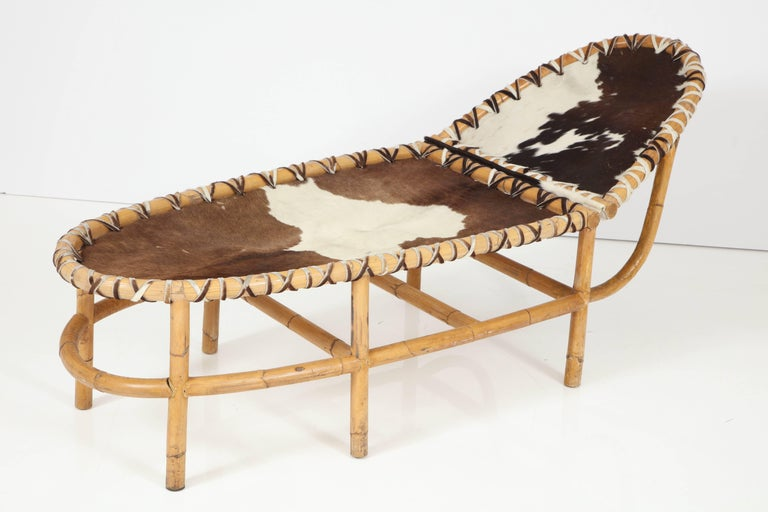 An unusual bamboo and cowhide chaise in the style of Gabriella Crespi, all original and vintage, the price includes full restoration.