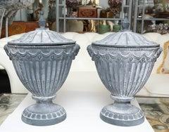 Pair of Covered Neoclassic Iron Garden Urns
