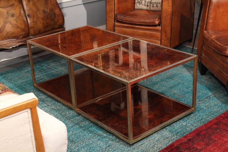 A matched pair of olivewood and gilt metal low tables in a simple yet beautiful square surface shape and the perfect cocktail table height.