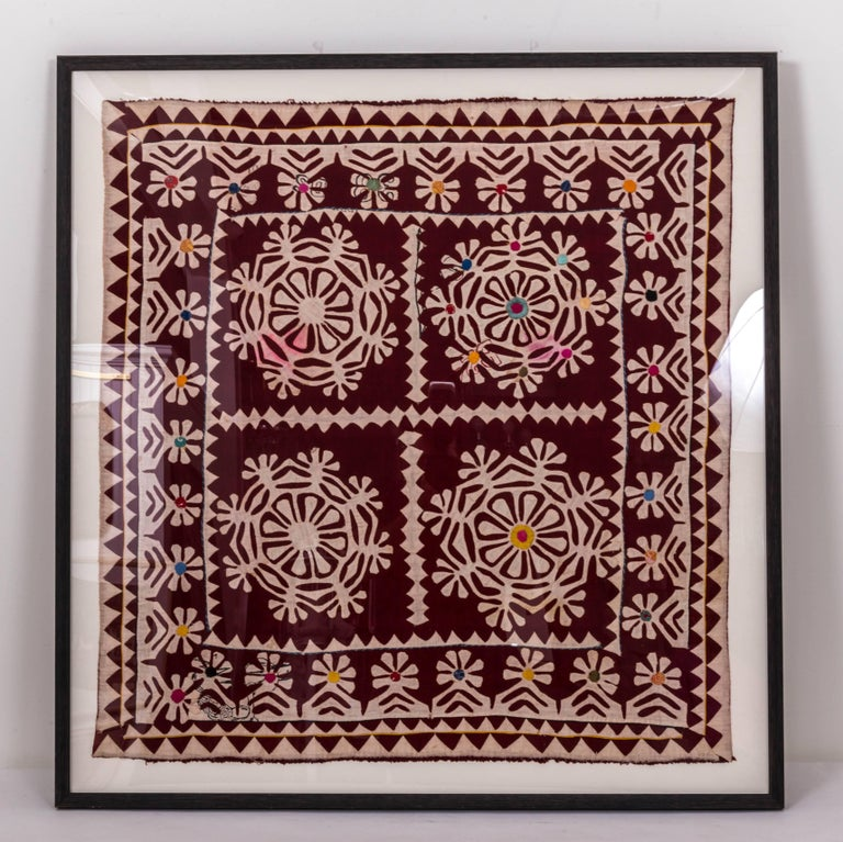 A piece of hand-sewn patchwork textile fragment India. It is made of dyed cottons sewed onto a cream background. There is a smaller piece measures 24 inch H x 24 inch W x 1 inch D.