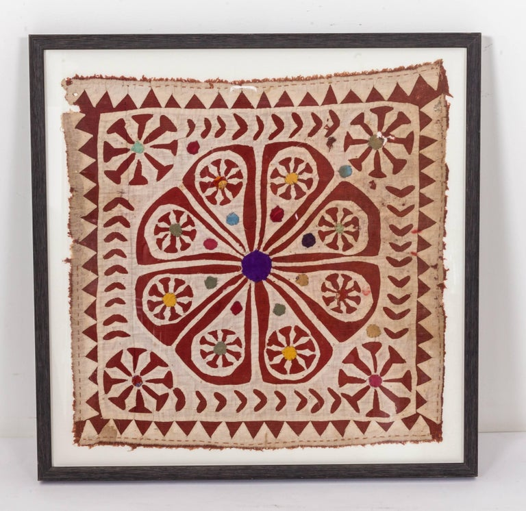 A piece of hand-sewn patchwork textile fragment India. It is made of dyed cotton sewed onto a cream background. There is a similar larger piece, measures 39 inch H x 37.5 inch W x 1.25 inch D.