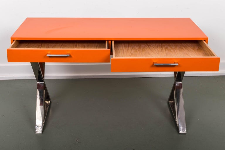 Beautiful orange lacquered base campaign desk by Milo Baughman. Restored like new finish.