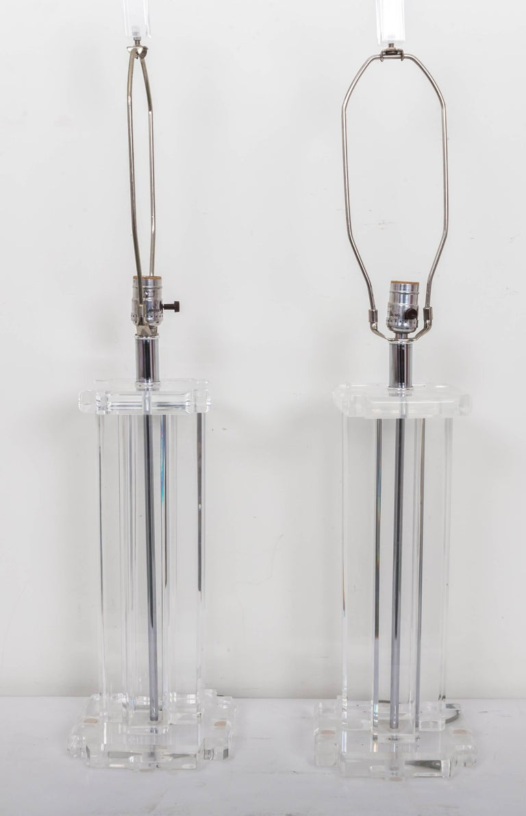 Four column Lucite lamp on square notched base capped with square notced top. Original finials of tall square shape. Clearlite by Bauer.