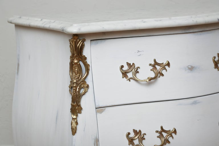 Louis XV style pair of painted petite commodes with white/grey marble tops by Auffray. Bronze mounts and pulls.