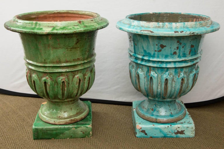 Pair of hand-painted blue and green terracotta planters.