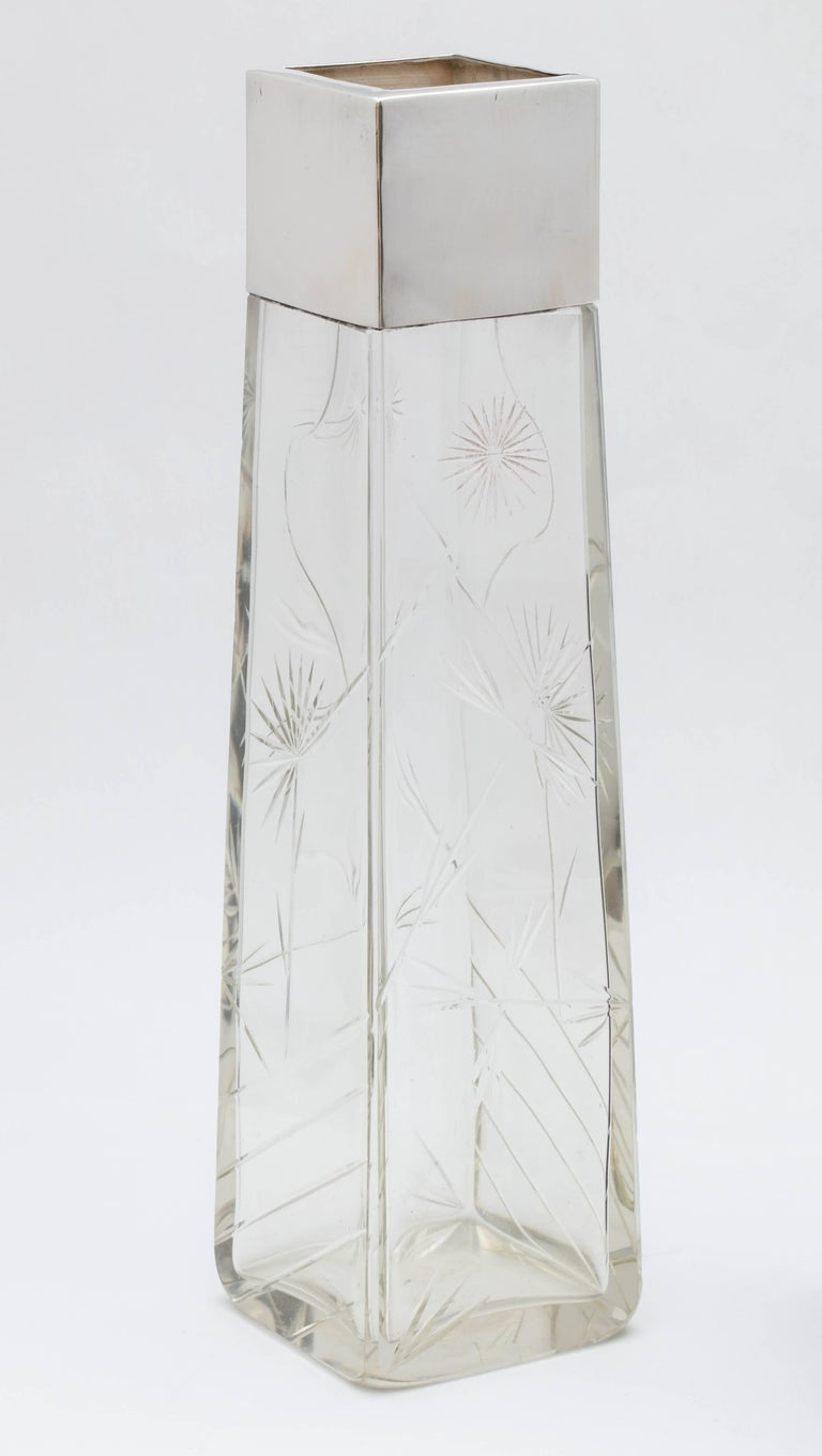 Lovely, Edwardian, sterling silver-mounted rectangular crystal vase in the Japonesque style, Birmingham, England, 1901, Sydney Thomas Steel - maker. Crystal is cut, having bamboo shoots, lines, etc. Measures: 12 inches high x 3 1/4 inches wide x 3
