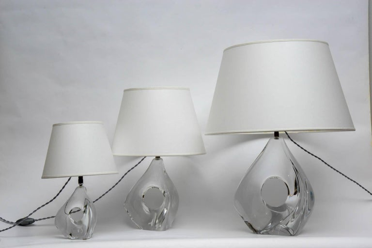 Set of three lamps in crystal by Daum France. Three dimensions, free form. Signed Daum, circa 1960.