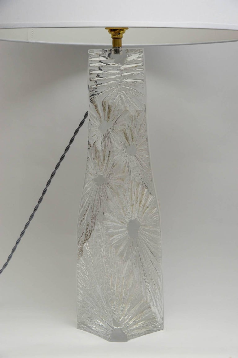 Elegant pair of lamps in crystal with abstract design. Each signed Daum, France circa 1960.