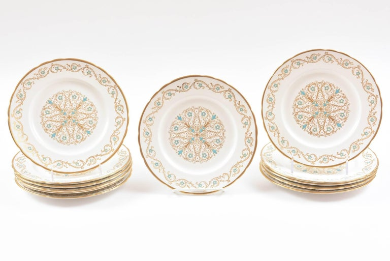 A sweet set of dessert plates with an all over gilt decoration highlighted with hand raised turquoise enamel. A slight scallop to the shape and it's the size you need over and over again for first course, salad, desserts, etc. In very nice vintage
