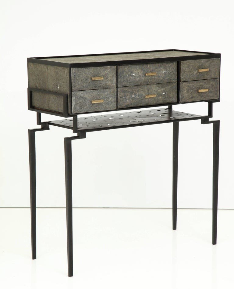 Decorative shagreen cabinet with carved palm wood legs, France.