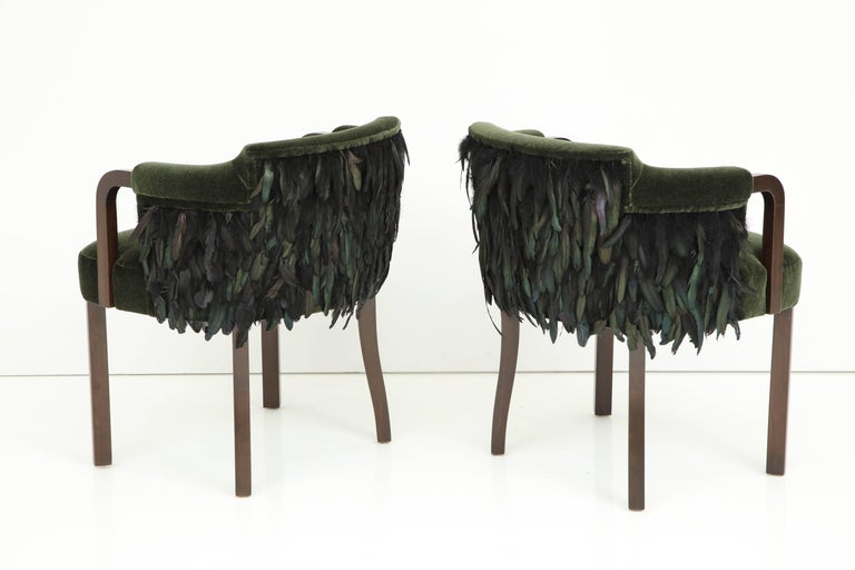 Fantastic pair of chairs with medium coffee brown stained Walnut frames upholstered in a heavy Dutch forest green Mohair with black/green iridescent sheen feathered back detail. Mint restored/ new upholstery/padding.  Arm height is 27.25