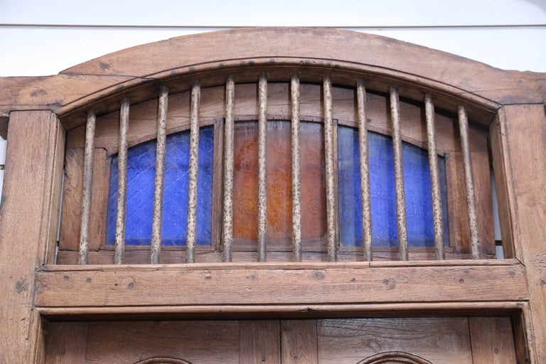 A very rare exceptionally well made solid teak wood window with original iron bars and hardware. It has shutters at the top. The churches built by the European settlers in the early 19th century are crumbling and are replaced with stronger concrete