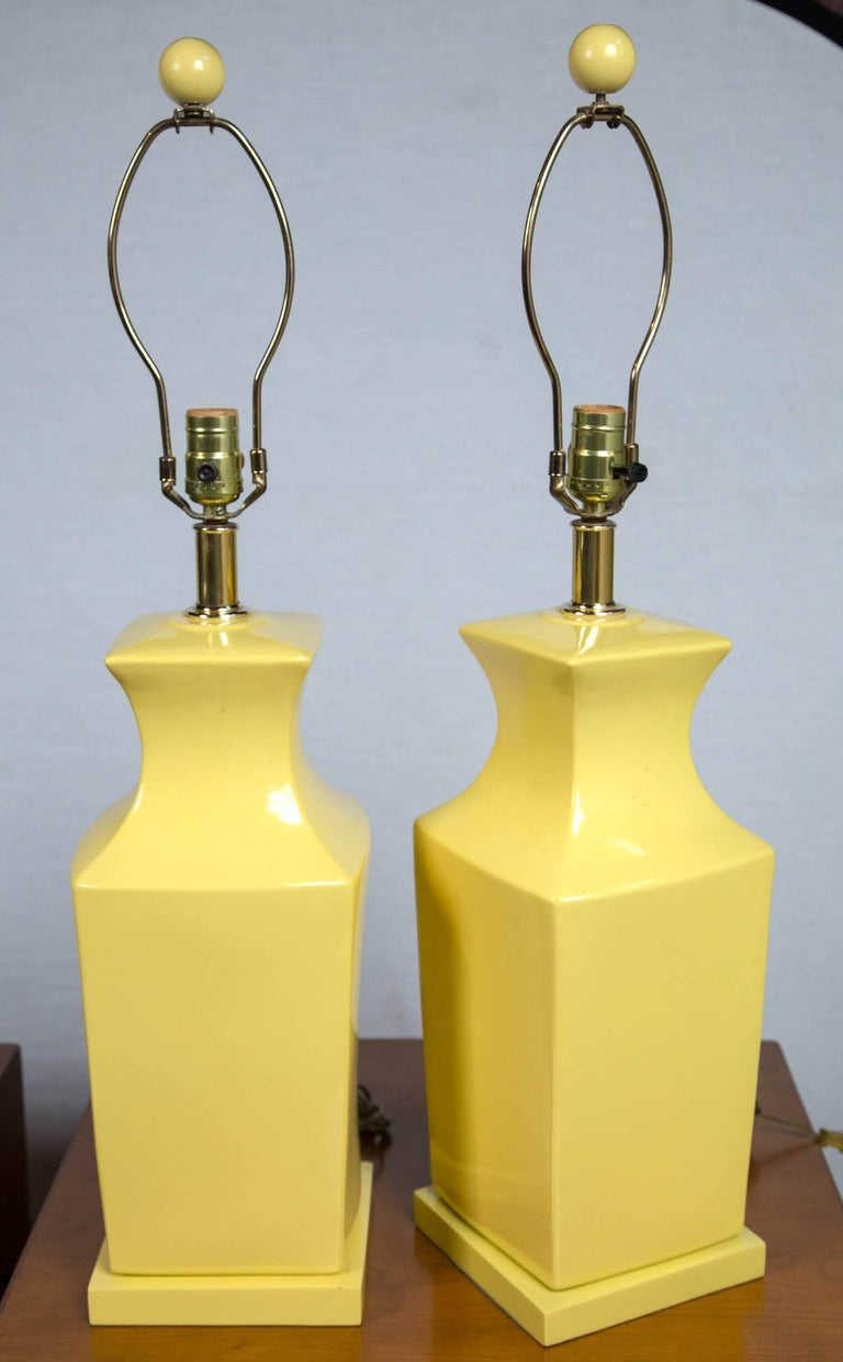 Pair of chinoiserie style yellow pottery lamps. Measures: 22