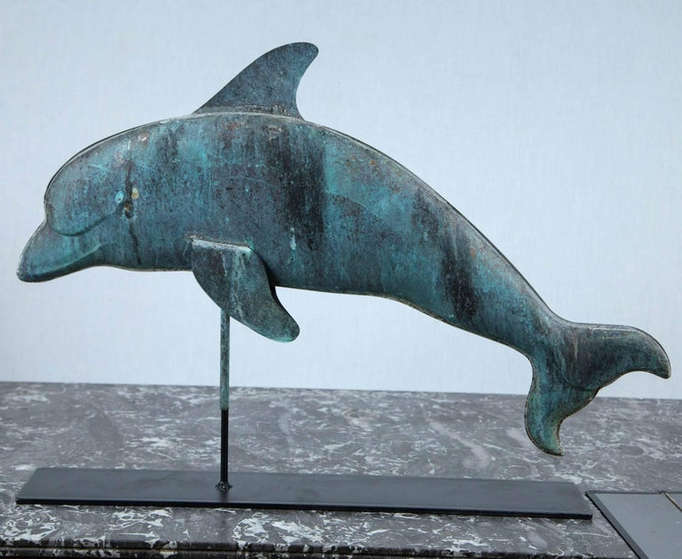 Weathervane in shape of a dolphin from New England.