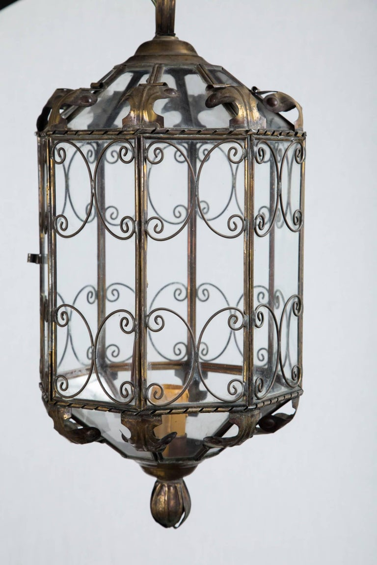 1940s octagonal Italian metal lantern electrified with on standard socket, original chain and canopy included. Delicate decoration makes this a lovely piece.