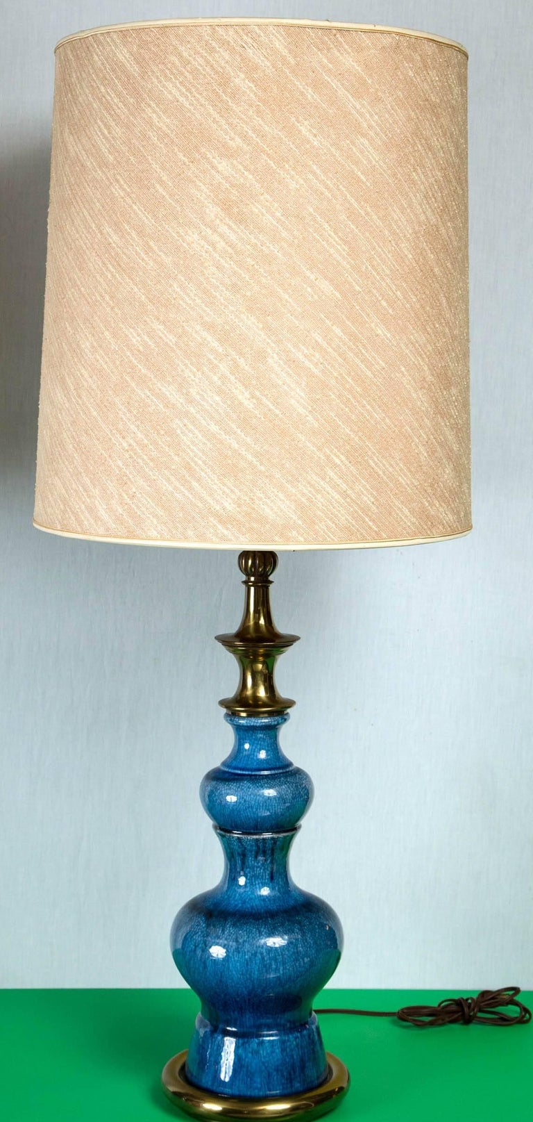 Pair of exquisite blue ceramic Stiffel lamps in a pagoda shape. Original shades included as in photos. Height is to top of finial.