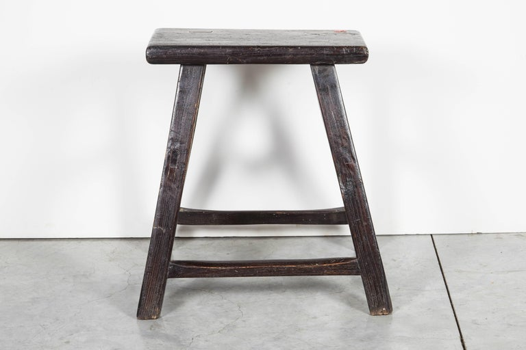 A Classic, simply designed antique Chinese stool with old paint and mortised joints. Perfect entryway piece, useful for extra seating or as a handsome side table.