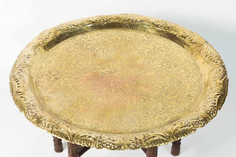 Anglo-Indian engraved and embossed large round polished brass tray coffee table.