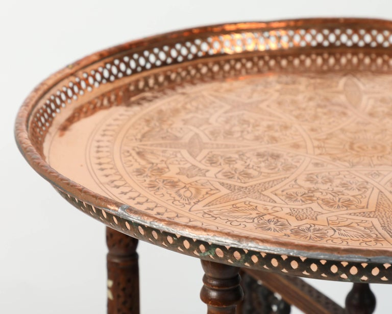 Moroccan Copper Tray Table with Folding Base In Good Condition For Sale In Los Angeles, CA