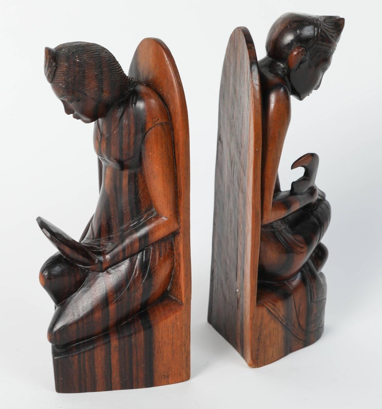 Hand carved wooden balinese bookends for sale at stdibs