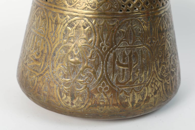 19th century Middle Eastern Islamic Syrian brass repousse bowl, finely hand-etched, engraved, hammered and chased with elaborate Moorish Syrian designs decorated with medallions of Arabic calligraphy inscriptions. Handcrafted brass metal work by