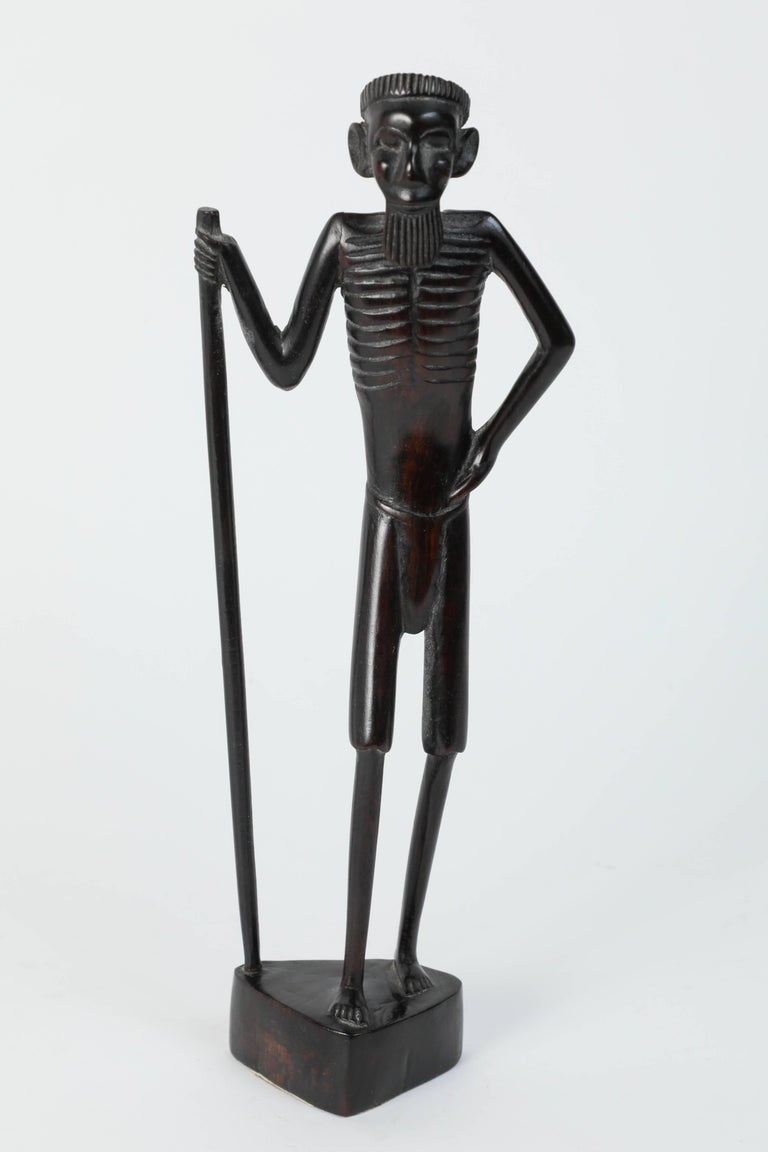 Decorative ebony well hand-carved African statues of two women and two warriors. Handmade in Kenya, Africa Measures: 1 - 14