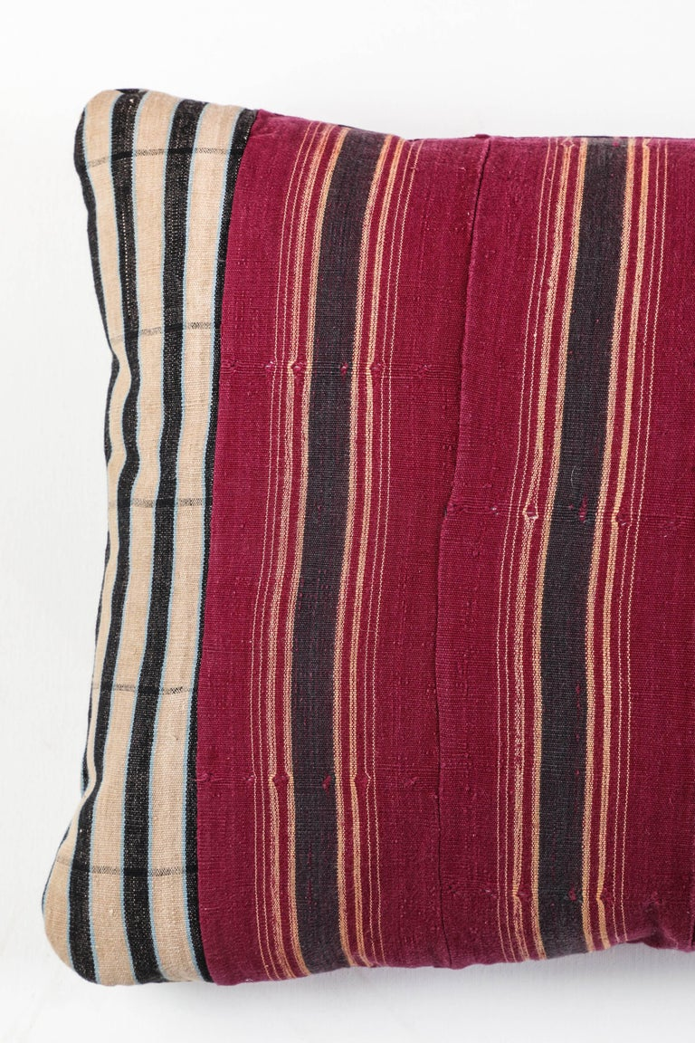 Pat McGann Workshop  Pillow made using vintage Ashante textile. Handwoven in Nigeria by the Yoruba Tribe. Long strips of cotton made on narrow looms. Front and back use fabric. Invisible zipper and feather and down fill.
