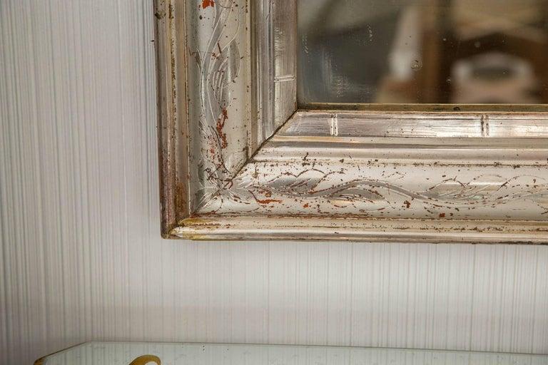 Patined silver leaf wood frame mirror, fine floral chiseling work, original mercury mirror.