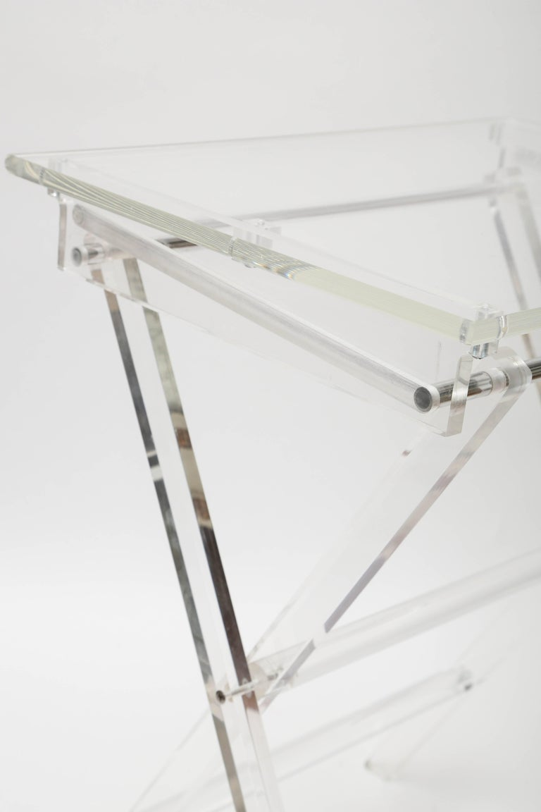 Set of two Lucite tray tables on stand. Each tray measures 15 x 20 x 25.5.
