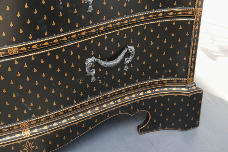 The pair are hand-painted and adorned with dramatic dolphin motif drawer handles as well as dolphin motif side handles.