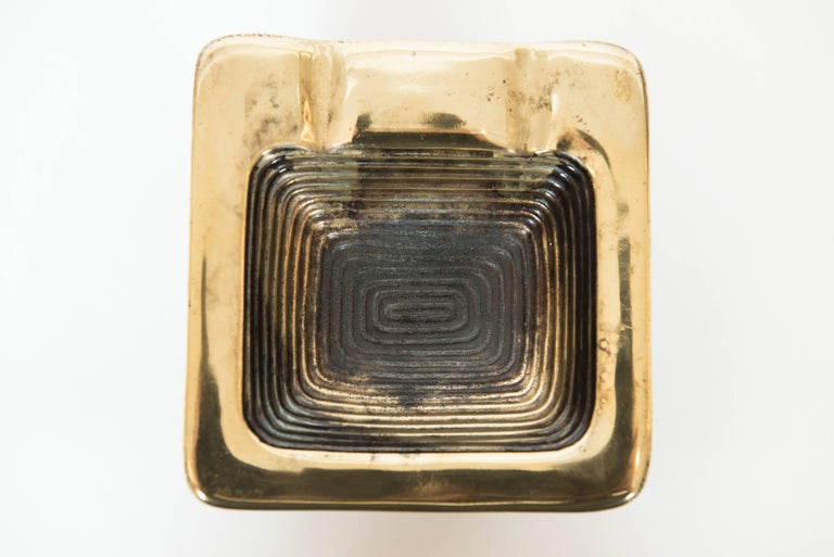 This ribbed Ben Seibel sculptural ashtray in antique brass finish adds panache to many a room!