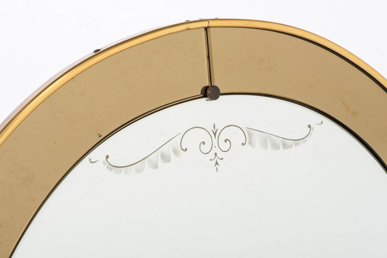 An oval wall mirror by Cristal Arte With a champagne glass border. Italy, circa 1960 Measure: 120 cm high x 92 cm wide x 4 cm deep.