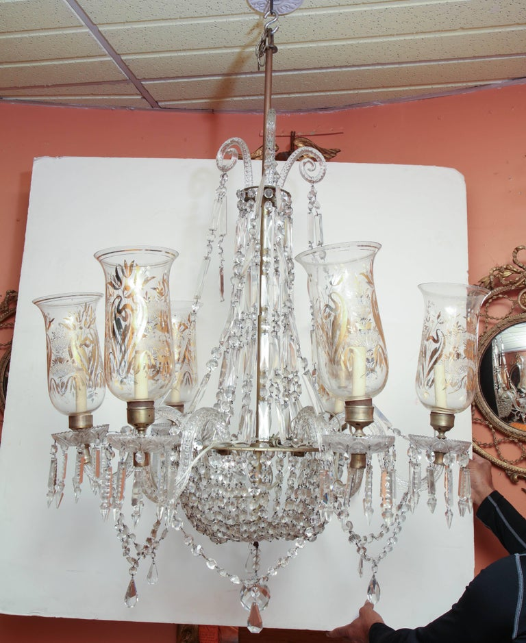 Late Regency crystal and etched glass hurricane glass six-arm chandelier.