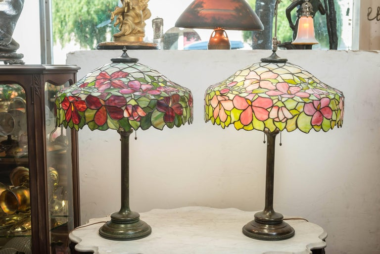 Offering a beautiful pair of lamps by a little known company to most people, but certainly well-known to the serious collector, the Unique Art Glass Co. Brooklyn N.Y.