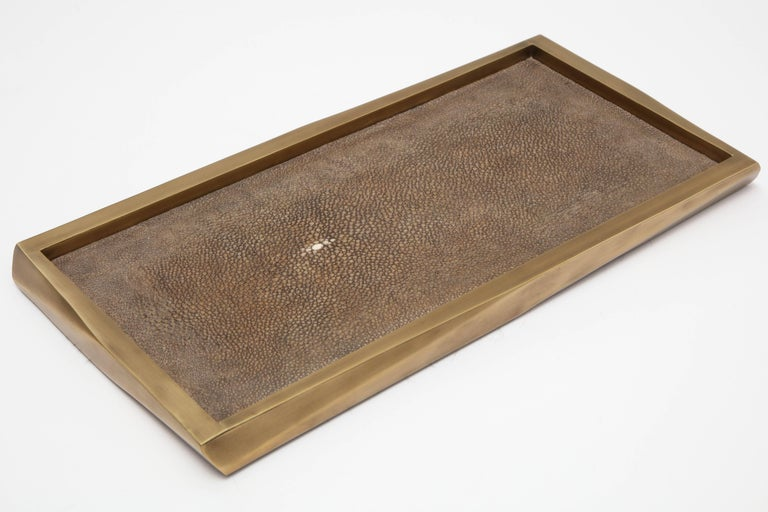 Dark taupe shagreen tray with a bronze border.
