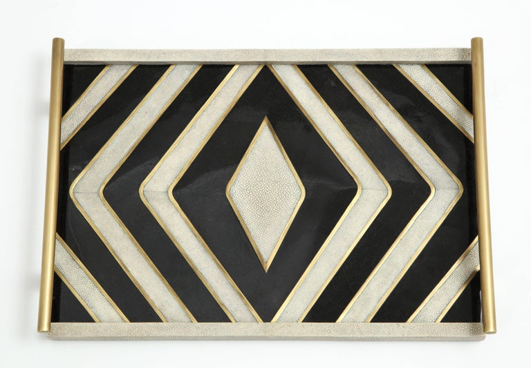 Decorative tray in cream shagreen with black sea shell. Details are made of bronze.