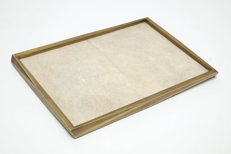 Cream colored shagreen tray with bronze border.