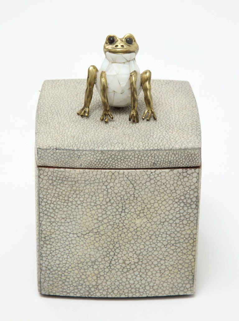Decorative shagreen box with frog on top.