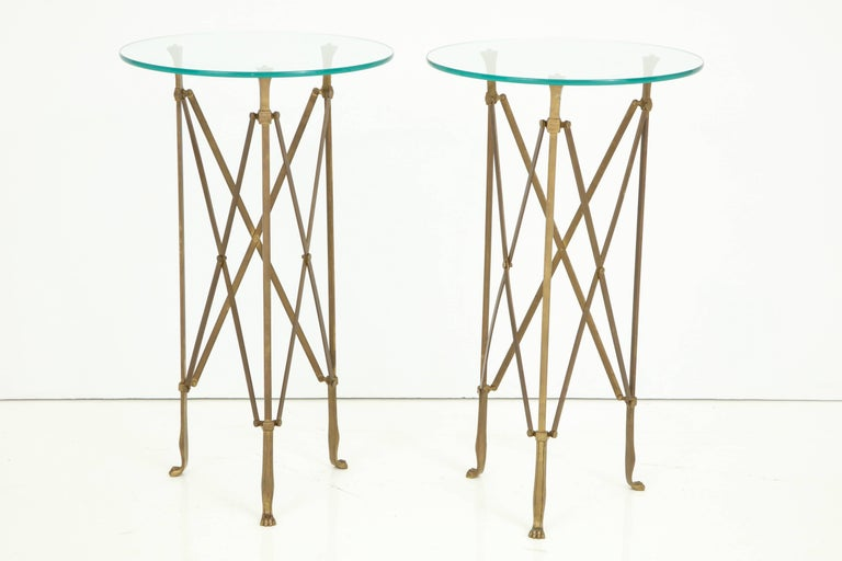 A pair of well proportioned neoclassical side tables in bronze, attributed to Jansen. The glass tops came with the tables and seem original but thicker glass or stone tops can be accommodated.