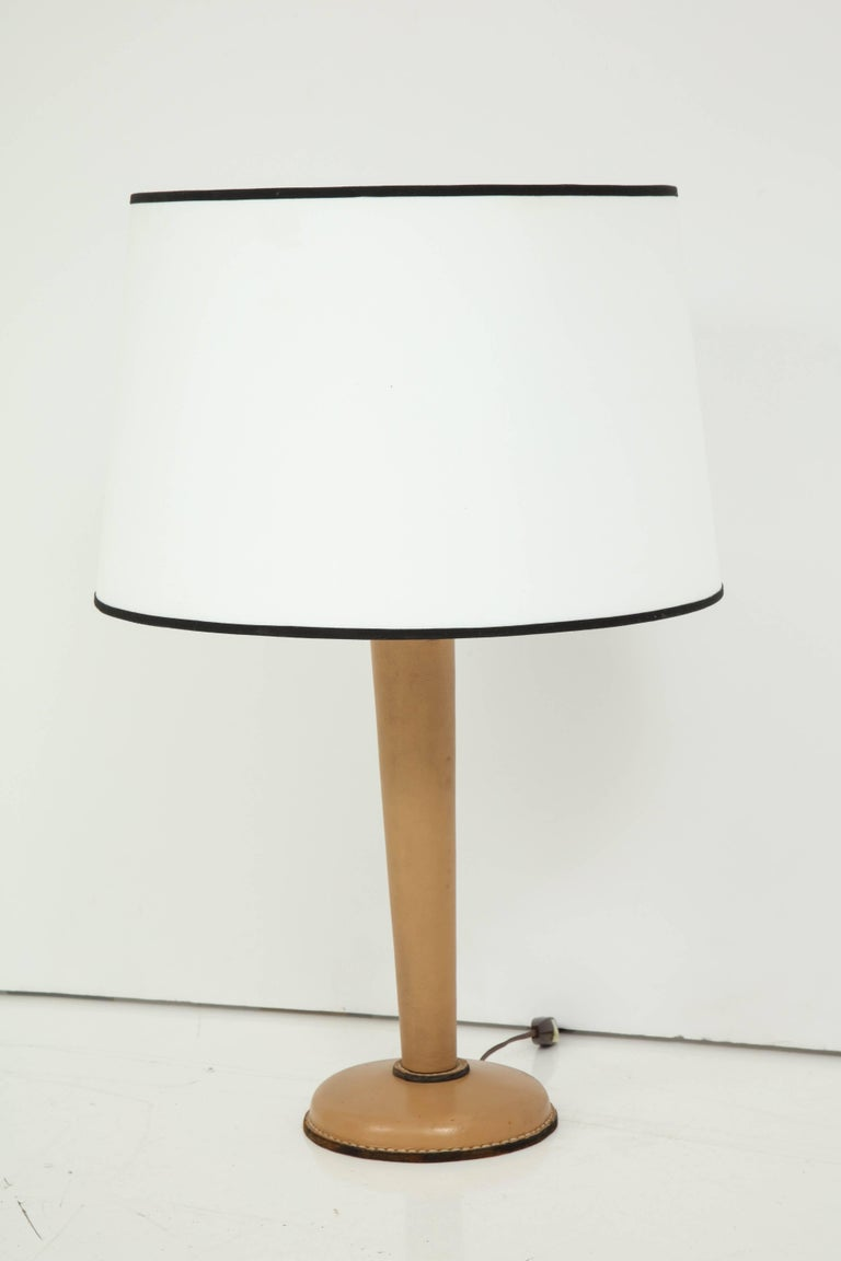 Tan stitched leather lamp by Jacques Adnet. Shade is for pictures and a custom one can be made on request. Base alone 7