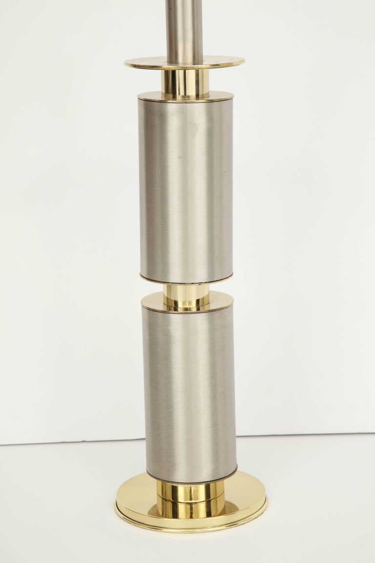 Modernist TOTEM style lamps with brushed steel bodies and polished brass accents and bases. Laurel Lighting Co., 1970s. Rewired for use in the USA, 100W bulbs.