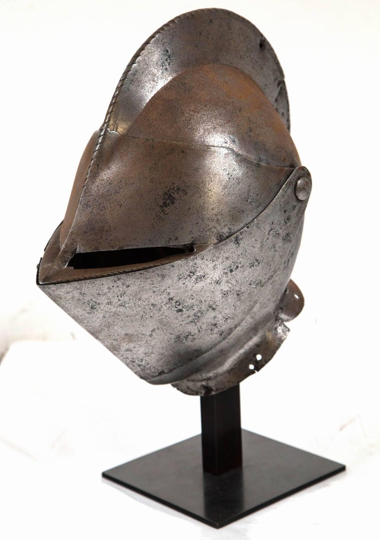 Antique Chevalier Helmet, France, 16th Century. Steel construction with hinged face plate. Wonderful aged surface. Professionally mounted on custom iron stand.