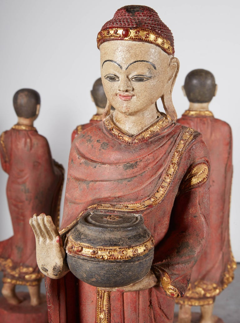 A complete set of five intricately carved vintage Burmese monks and Buddha in flowing robes on lotus leaf and carrying alms bowls. Spiritual and beautiful, these pieces are extraordinarily detailed (see additional photos). 